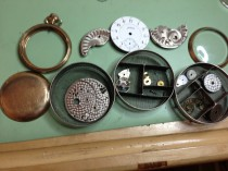 pocket watch movement disassembled for cleaning and repair
